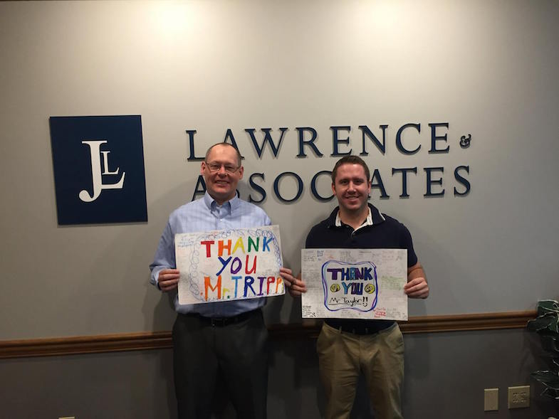 Pete Tripp And Jesse Taylor, From Lawrence & Associates, Receive Thank You Cards From Children To Whom They Presented A Trial Exhibition.