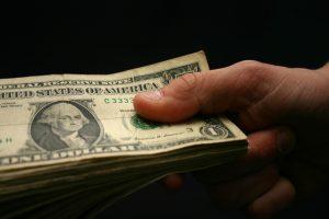 holding-money-1315930-639x426
